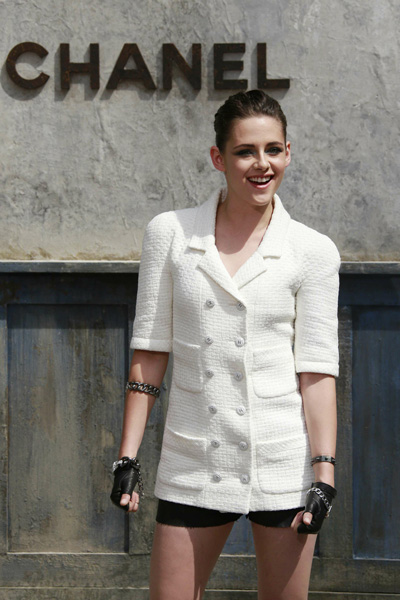 Actress Kristen Stewart poses during a photocall before the Haute Couture Fall Winter 2013/2014 fashion show for French fashion house Chanel in Paris